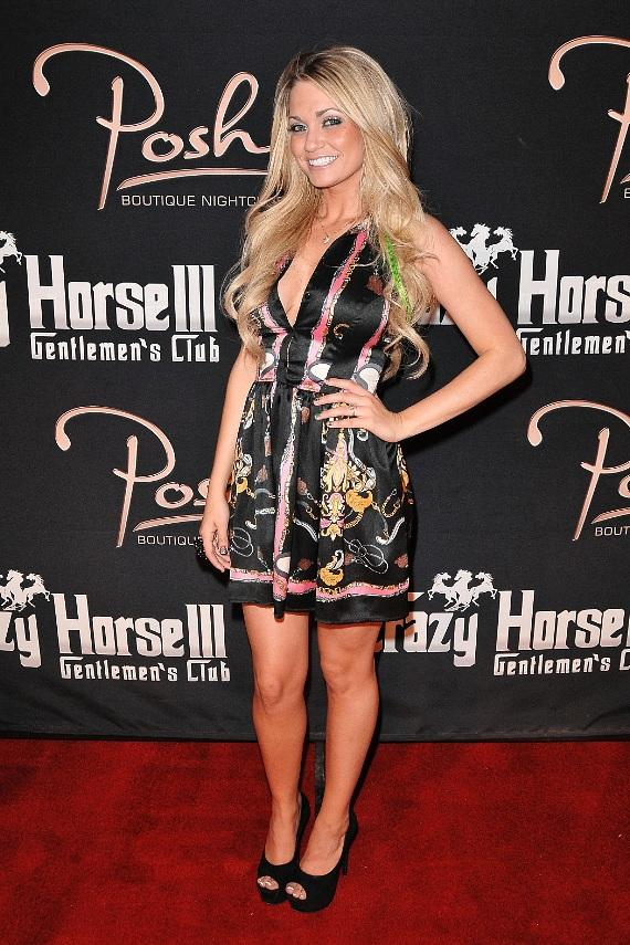 Angel Porrino poses on the red carpet at Crazy Horse III Gentlemen's Club and Posh Boutique Nightclub