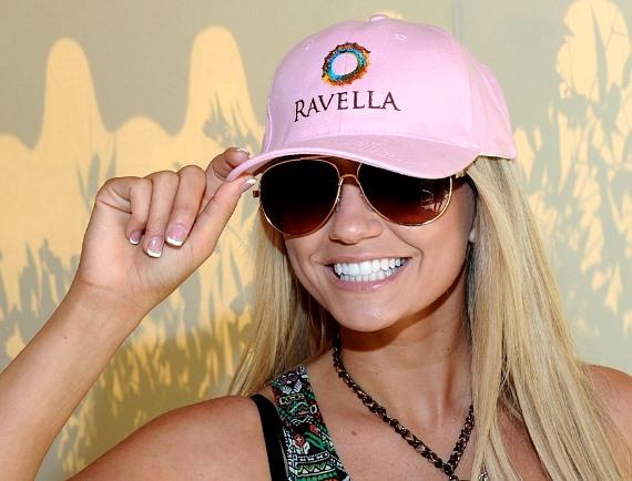 Angel Porrino sporting a pink Ravella hat at The Pool at Ravella, Las Vegas
