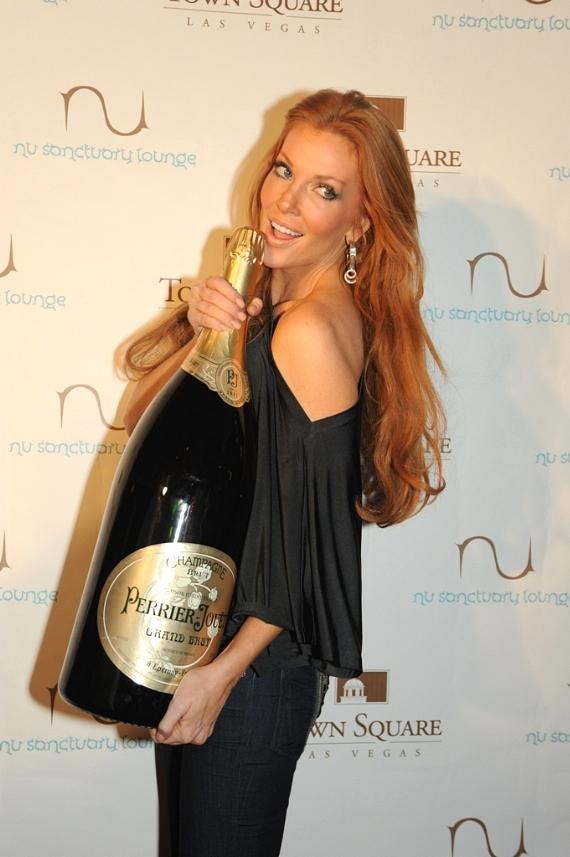 Former Baywatch star Angelica Bridges with a 9-liter bottle of Perrier-Jouet champagne