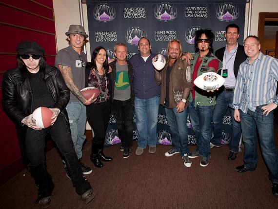 (L to R) Mick Mars; Tommy Lee; Suzanne Richardson, Marketing Director, AEG Live Las Vegas; John Nelson, Vice President, AEG Live Las Vegas; Bobby Reynolds, Vice President of Booking, AEG Live Las Vegas; Vince Neil; Nikki Sixx; Paul Davis, Vice President of Entertainment, Hard Rock Hotel & Casino; Mike Garipay, Vice President of Operations, Warner Gaming LLC
