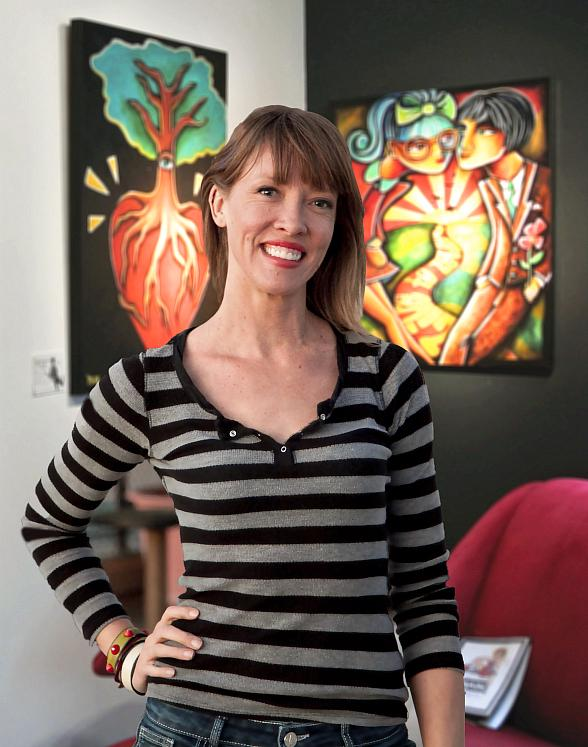 Jennifer Main with two pieces of her artwork