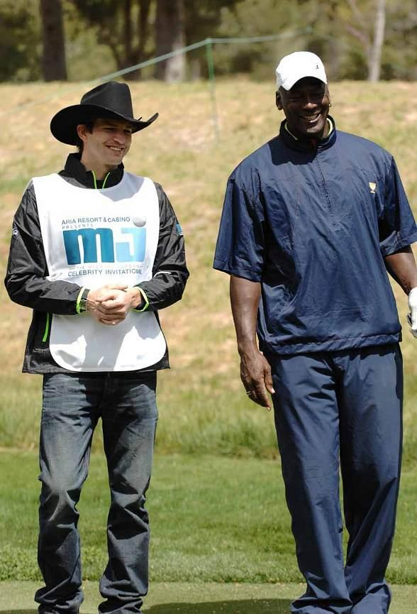 Ashton Kutcher and Michael Jordan laughing at MJCI, Las Vegas