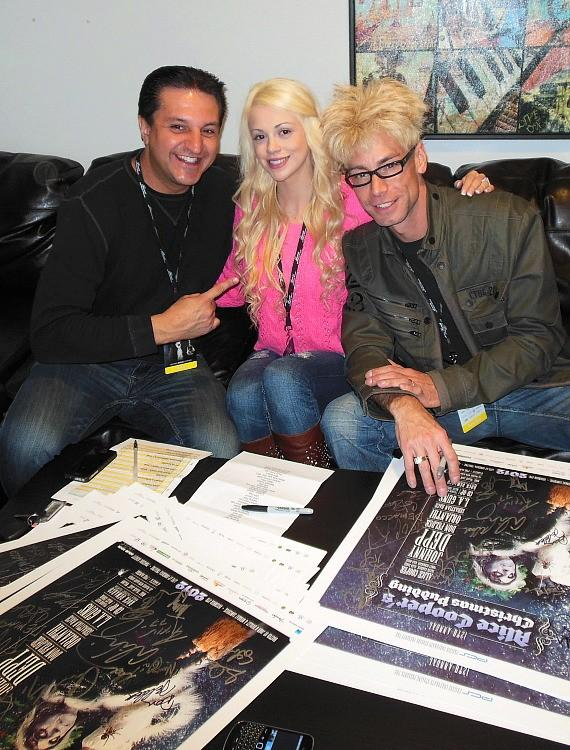 "Doug ""Lefty"" Leferovich, Chloe Crawford and Murray SawChuck autographing auction posters"