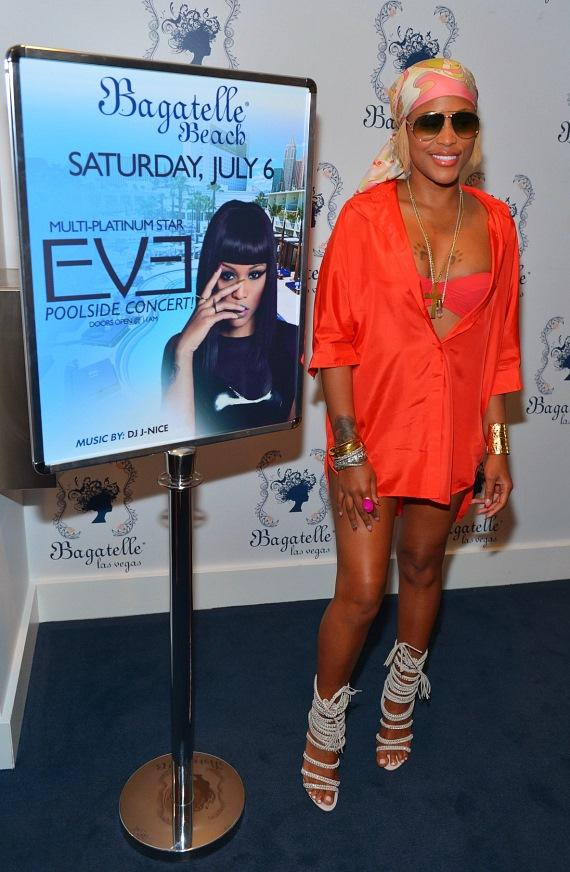 Eve with her poster at Las Vegas' Bagatelle Beach