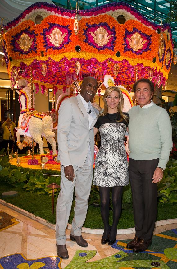 Preston Bailey, Andrea Wynn and Steve Wynn pose in front of Animated Carousel