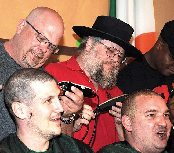 Rick Harrison of Pawn Stars and Mark Hall-Patton from Clark County Heritage Museum shave heads for St. Baldrick's Foundation