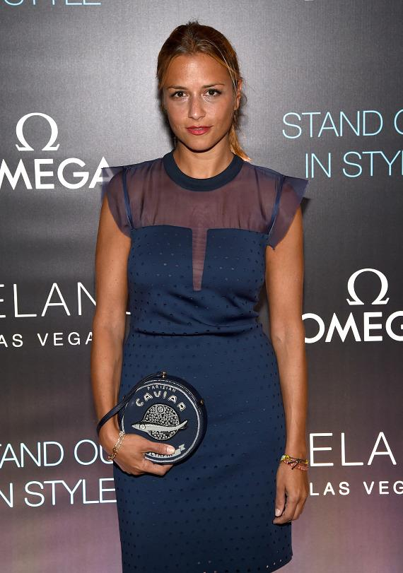 Before the grand opening of Delano Las Vegas, fashion designer Charlotte Ronson poses on the red carpet