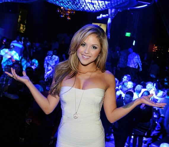 Brittney Palmer poses in front of dance floor of Gallery Nightclub