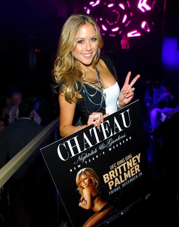 Brittney Palmer poses with her poster