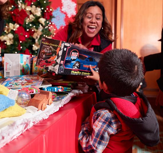 Child picks out a toy at Annual Easter Seals Nevada Holiday Party at Texas Station