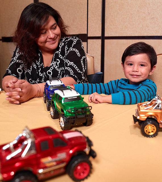 Child with toys at Annual Easter Seals Nevada Holiday Party at Texas Station