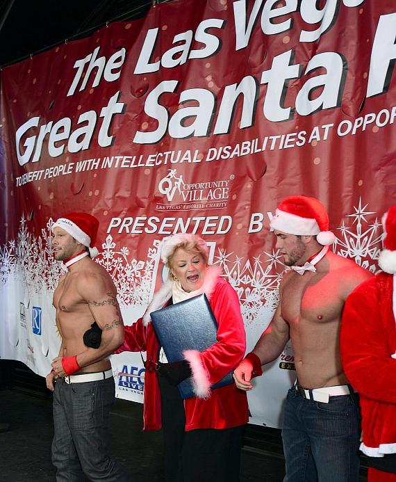 Mayor Carolyn Goodman dances with members of Chippendales