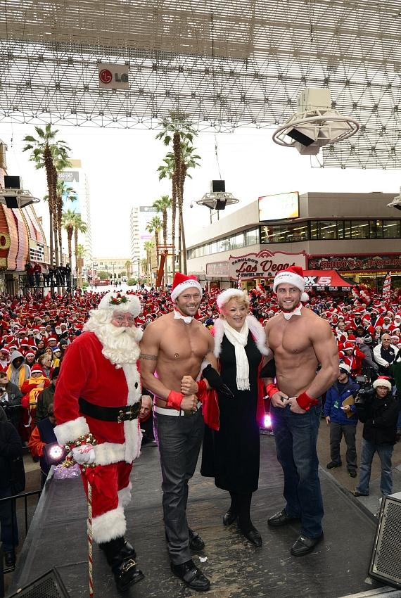 Santa with Mayor Carolyn Goodman and members of Chippendales