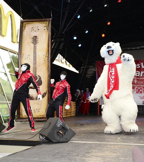 Jabbawockeez dance on stage with giant polar bear