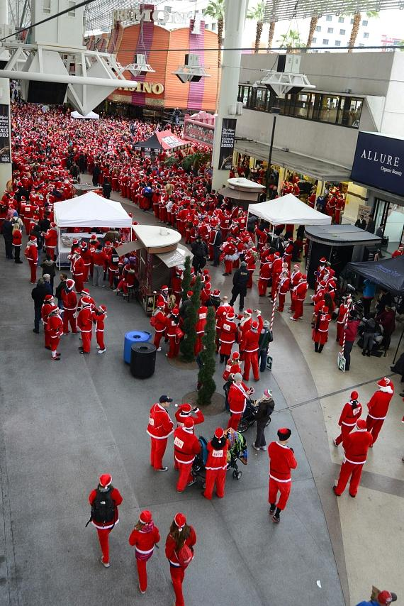 Santa Claus lookalike runners line up on Fremont Street in Las Vegas