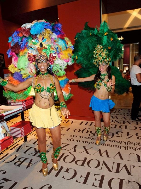 Carnivale Costumed Samba dancers at Assouline for Fashion's Night Out