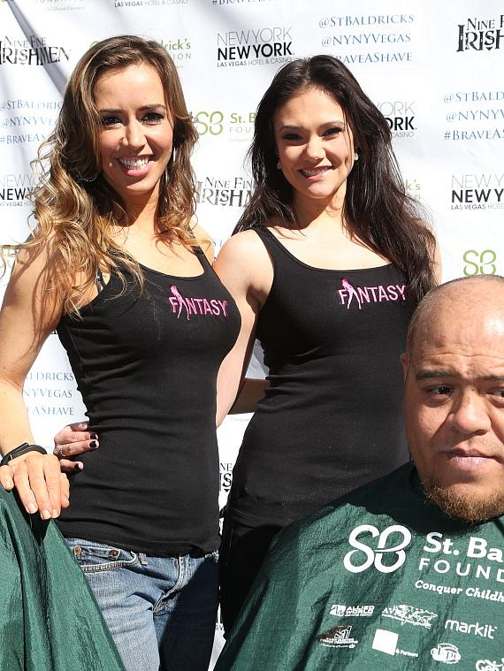 FANTASY cast members Mariah Nieslanik Rivera and Danielle Aveyard pose for a photo before shaving heads at New York-New York's 6th annual St. Baldrick's Event