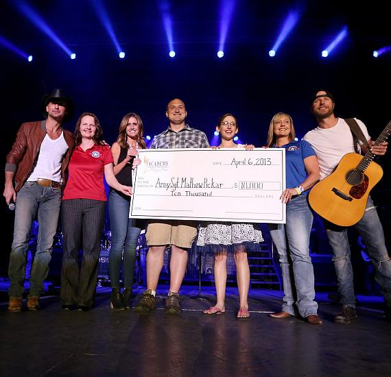 Check presentation with Army Sgt. Mathew Pickar, Tim McGraw and Dierks Bentley