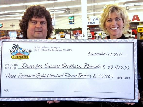 La Isla Uniforms Check Presentation – Dimitrios Stavros, director of operations of La Isla Uniforms, pictured with Paula Lawrence, a board member of Dress for Success Southern Nevada.   La Isla Uniforms donated $3,815.55 to Dress for Success Southern Nevada in honor of its Ninth Anniversary