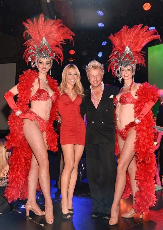 Lydia Ansel and Chris Phillips with Las Vegas Showgirls