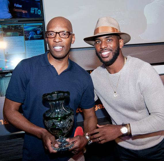Chris Paul presents Sam Cassell with the 2015 2015 TopSpin Charity Ping Pong Tournament trophy