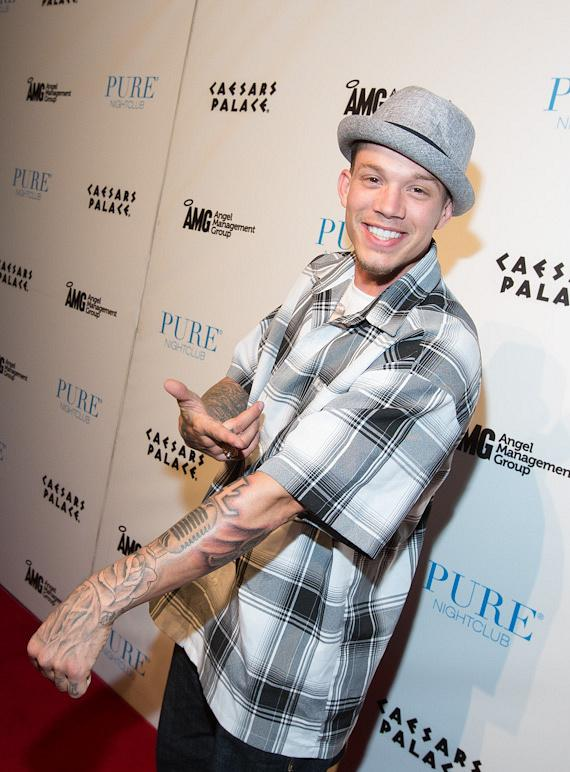 The X Factor's Chris Rene shows off his new tattoo on the red carpet at PURE Nightclub