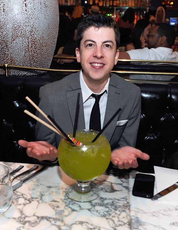 Christopher Mintz-Plasse drinking a Lollipop Passion goblet at Sugar Factory