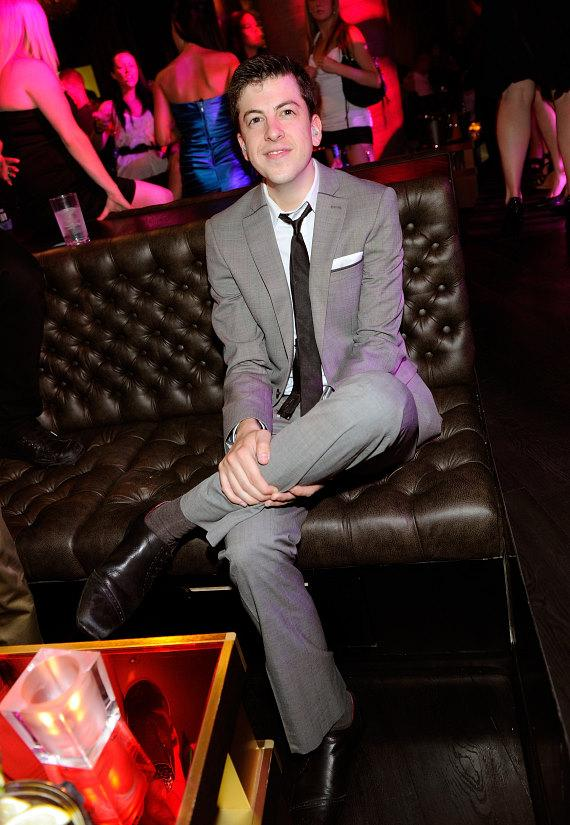 Christoper Mintz-Plasse posing at his VIP table at Gallery Nightclub