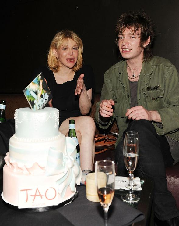 Courtney Love & Mico with cake at TAO