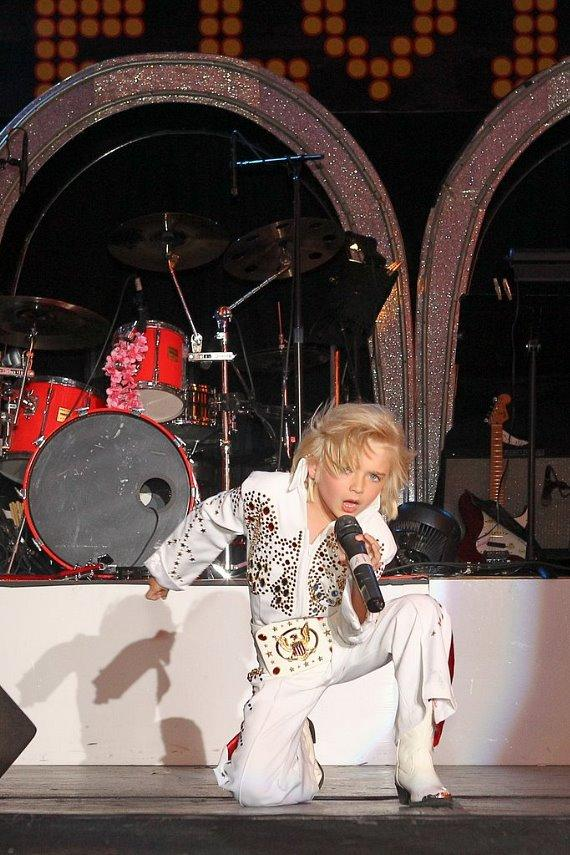 """Six year-old Gabriel """"The Storm"""" Jarrett performs at Fremont Street Experience during the Ultimate Elvis Weekend"""
