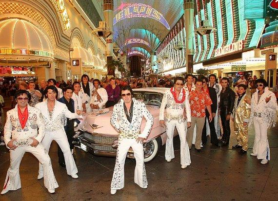 "The 20 ""Elvis"" competitors parade at the start of the Ultimate Elvis Tribute Artist Contest at Fremont Street Experience"
