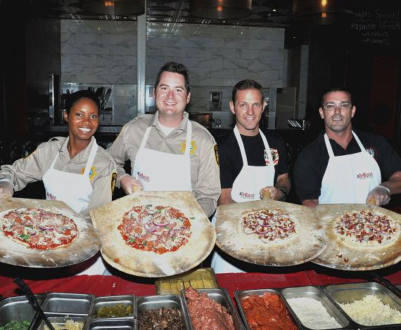 Members from the local non-profit organizations Friends of Las Vegas Metro Police Foundation and Firefighters of Southern Nevada Burn Foundation created two signature pizzas that will live on the Dom DeMarco's menu throughout October, National Pizza Month. Each pizza sales will benefit the organizations and at the end of the month the non-profit with the highest pizza sales will receive an additional 10% from Dom DeMarco's in addition to the amount raised.