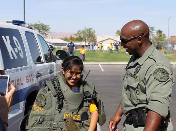 The kids took pictures and interacted with Henderson Public Safety Assets (SWAT, K-9, Traffic Units, Fire and Rescue Units)
