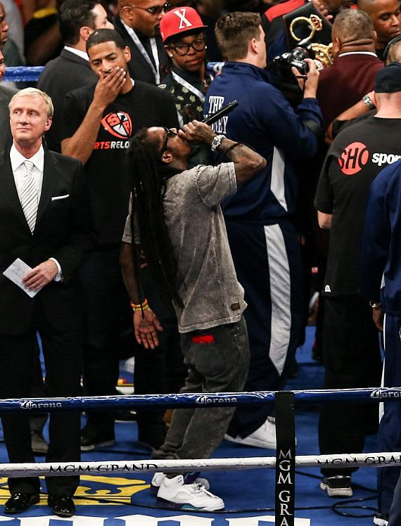 Lil Wayne sings as Mayweather enters the ring