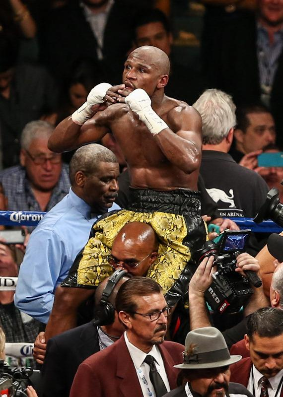 Floyd Mayweather Jr. celebrates his victory