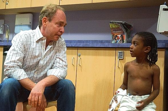 Teller with a UMC Pediatric unit patient