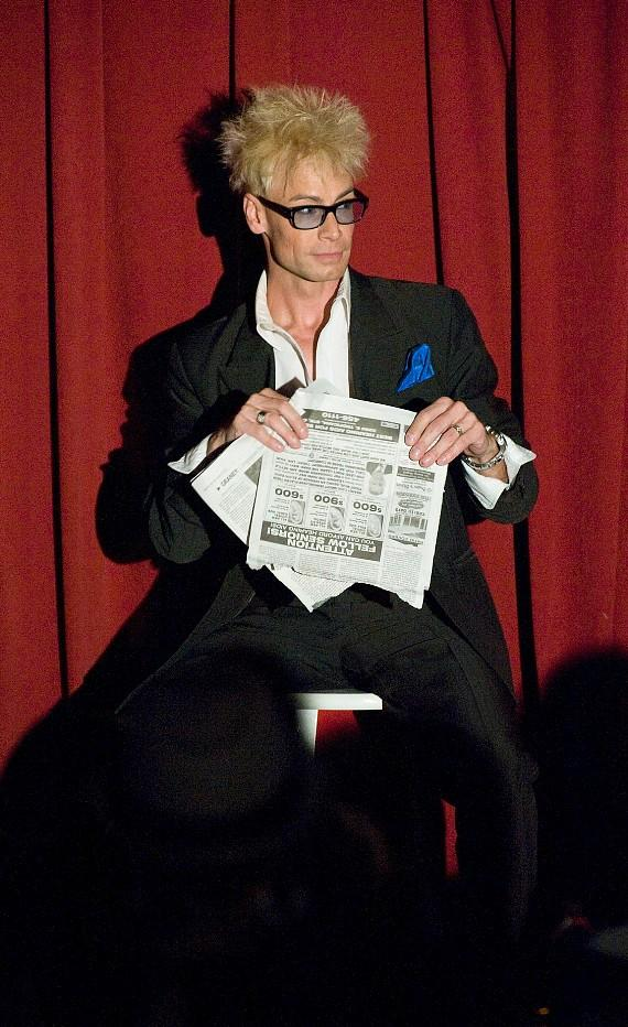 Murray performs his final trick of the night, The Torn & Restored Newspaper