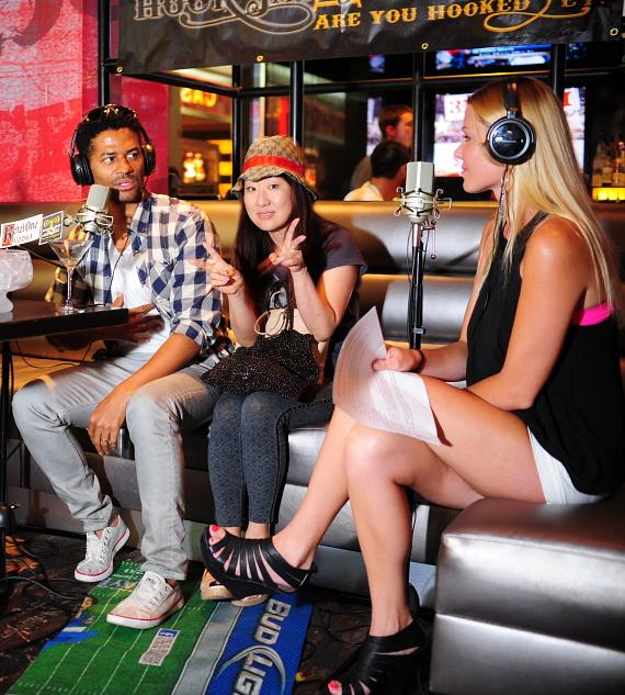 "Eric Benét and a fan with co-host Christina ""CC"" Christensen in PBR Rock Bar"