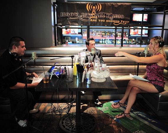 "Co-hosts Robert Blasi and Christina ""CC"" Christensen interview Anthony Cools (center)"