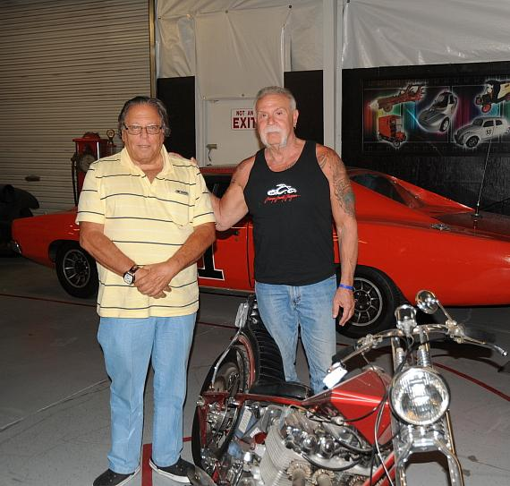 Michael Dezer and Orange County Chopper Paul Senior admire the 1970s Arlen Ness old school chopper at Hollywood Cars Museum in Las Vegas