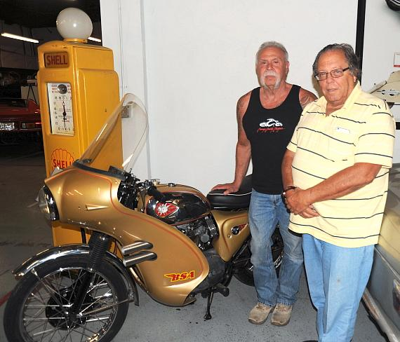 "Paul Sr. (left) of Orange County Choppers fame with Michael Dezer's (right) BSA from James Bond ""Thunderball"" at the Hollywood Cars Museum in Las Vegas"