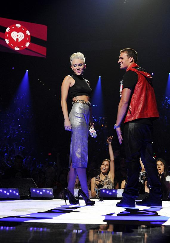 Miley Cyrus and Ryan Lochte on stage at iHeartRadio Music Festival