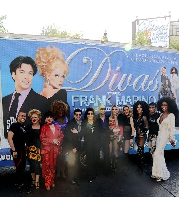 "Frank Marino, flanked by Alex Schechter on the left and Adam Steck on the right, as well as cast members of ""Divas Las Vegas"" in front of the show's new mobile billboard"