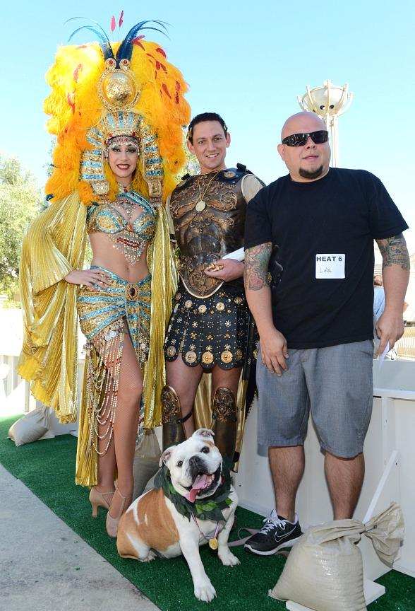 "Winner of the inaugural ""Running of the Bulldogs,"" Lola, and her owner, Anthoney Apalategui, pose with Caesar and Cleopatra at Caesars Palace"