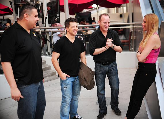 "Robert Blasi, Mark Shunock and Christina ""CC"" Christensen outside PBR Rock Bar in Las Vegas"