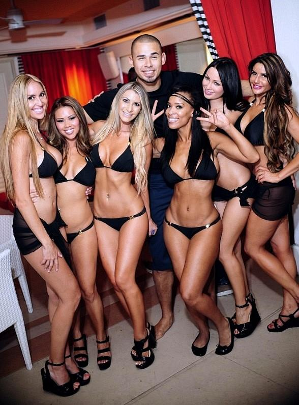 DJ Afrojack with servers at Surrender Nightclub