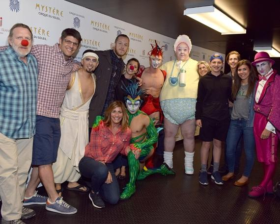 Dan Reynolds and his family with cast members of Cirque du Soleil