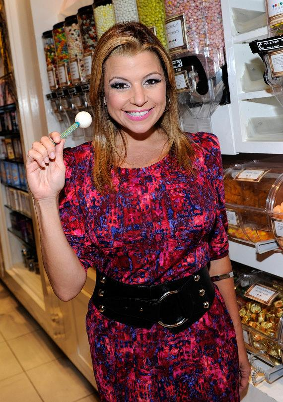 Dana Wilkey holding a white Signature Sugar Factory Couture Pop at Sugar Factory