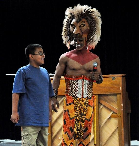 Daniel Hernandez and Niles Rivers as Simba at surprise LION KING assembly at Walter Long Elementary School