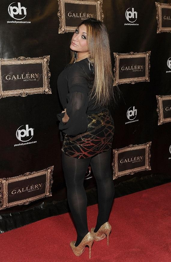 Deena Nicole poses on the red carpet at Gallery Nightclub at Planet Hollywood